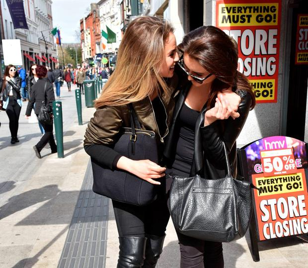 Models Thalia Heffernan & Holly Carpenter joked they are Ireland's hottest new couple as they laughed, kissed and held hands walking down Grafton Street