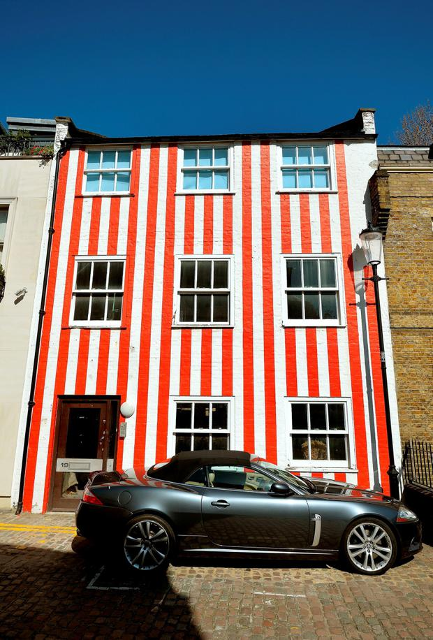 A red and white striped house in South End, Kensington, London, which was apparently painted by the owner in protest at a planning application being turned down on improvements to the property.