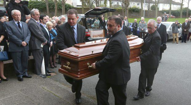 The Coffin is carried into St Lawerence O'Tooles Church in Kilmacud for the funeral of Ray Treacy