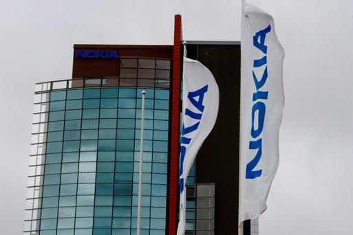 Nokia Oyj is in talks to buy smaller telecom equipment maker Alcatel-Lucent, a deal that would combine the industry's two weakest players but could pose challenges in cutting costs and overcoming political opposition. Photo: Reuters