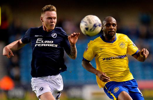 Millwall's Aiden O'Brien battles for the ball with Wigan's Emmerson Boyce