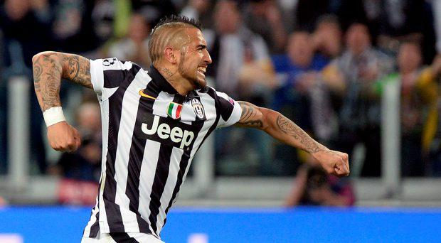 Juventus' Arturo Vidal celebrates after scoring his side's first goal during the Champions League, quarterfinal, first leg soccer match between Juventus and Monaco