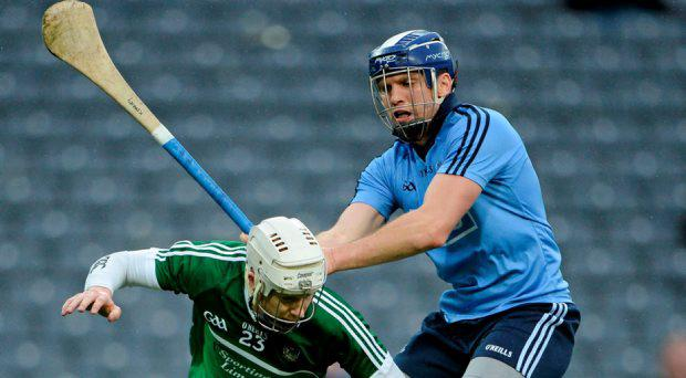 Cian Lynch, Limerick, in action against Conal Keaney, Dublin