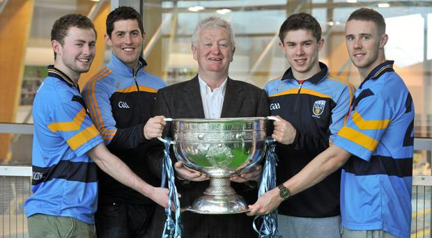 UCD GAA Executive Dave Billings with the Sam Magiuire Cup and Dublin footballers, from left, Jack McCaffrey, Rory O'Carroll, Davy Byrne and Paul Mannion in 2014