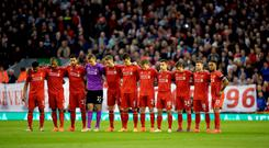 Liverpool players observe the minutes silence for the Hillsborough disaster before the Barclays Premier League match against Newcastle on Monday