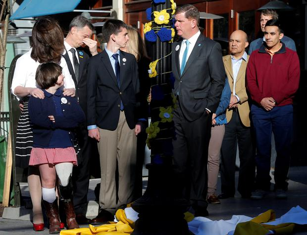 The family of Boston Marathon bombing victim Martin Richard with Boston Mayor Marty Walsh (C) Credit: Brian Snyder