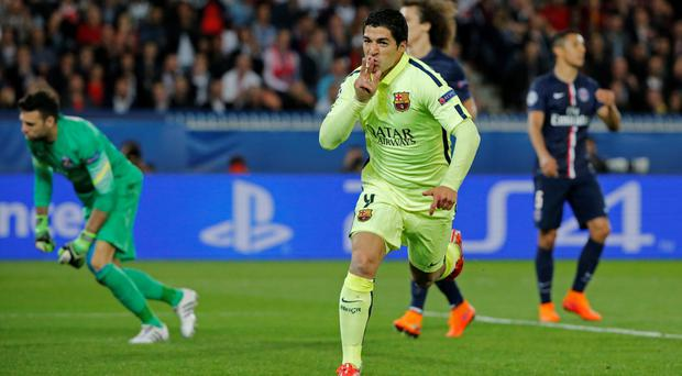 Luis Suarez celebrates after scoring the second goal for Barcelona