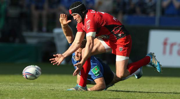 Leinster's Jimmy Gopperth loses out to Toulon's Matt Giteau in a race for the ball during last year's quarter-final clash. Gopperth insists they've learned plenty of lessons from that defeat