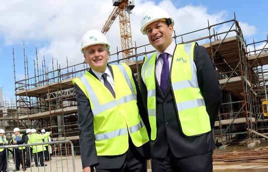 Health Minister Leo Varadkar and his northern counterpart Jim Wells at the site of Altnagelvin Hospital