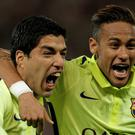 Deadly Duo: Barcelona's Luis Suarez, left, celebrates with Neymar after scoring his team's second goal during the Champions League quarter-final clash with PSG in Paris last night.
