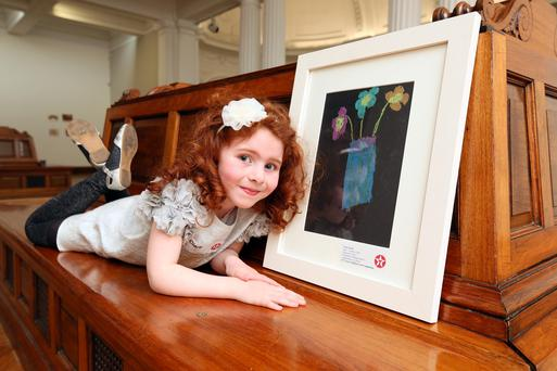 Ciara Ward from St Malachy's Primary School, Castlewellan, Co Down who won category F with her painting 'Fabulous Flowers'
