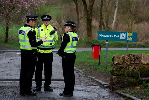 Police outside Dawsholm Park in Glasgow where the handbag which police believe belongs to missing student Karen Buckley was found early this afternoon. Andrew Milligan/PA Wire