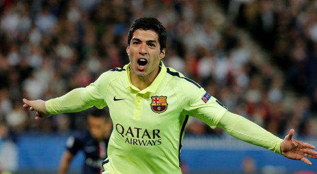 Luis Suarez celebrates after scoring the third goal for Barcelona