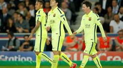 Barcelona's Neymar, Luis Suarez and Lionel Messi looking pleased last night