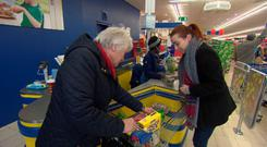 Dail on The Dole Episode 1 TD Catherine Byrne with single mum Laura Spencer doing her weekly shop