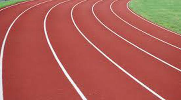 An athletics coach in Uganda has been charged with raping three teenage girls he was coaching.