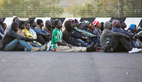 Migrants rest after they disembarked in the Sicilian harbour of Augusta REUTERS/Antonio Parrinello