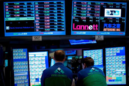 Specialist traders work at a Virtu Financial booth on the floor of the New York Stock Exchange. Photo: Reuters