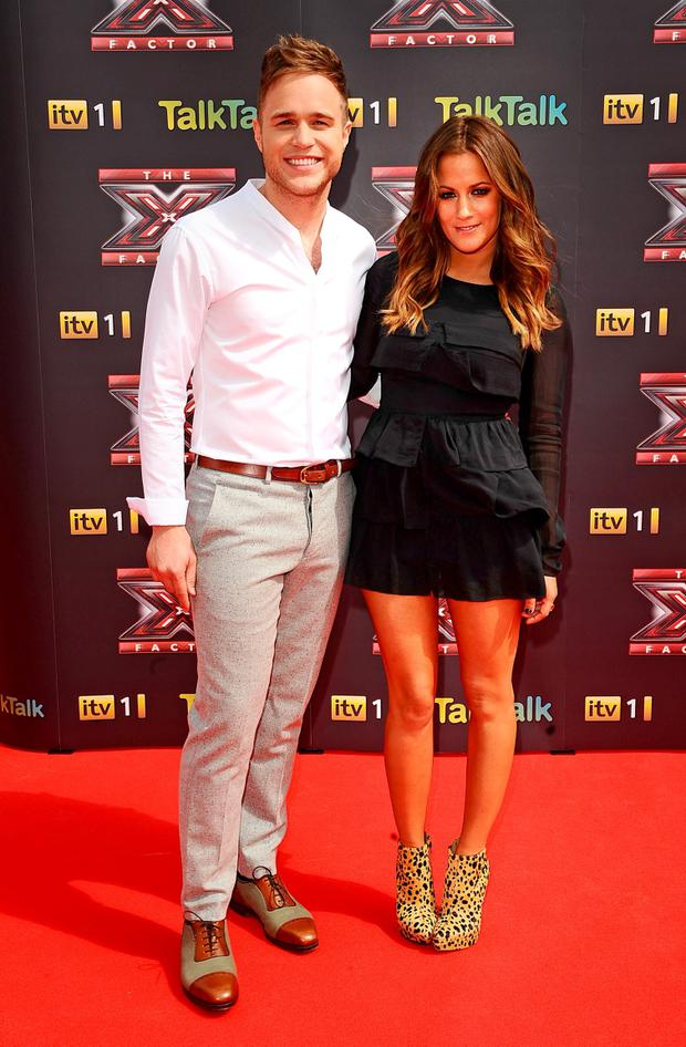Olly Murs and Caroline Flack Credit: Ian West/PA Wire