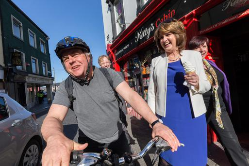 Tanaiste Joan Burton met local man Vincent O'Shea after she stopped for an ice cream on the canvass in Kilkenny yesterday. Picture: Dylan Vaughan