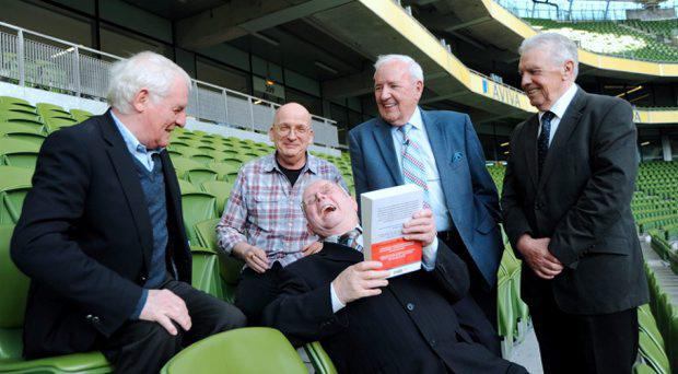 Former Republic of Ireland Kit-man Charlie O'Leary, front, with copy of Roddy Doyle's book 'The Barrytown Trilogy', with l-r; Eamon Dunphy, Roddy Doyle, Bill O'Herlihy and John Giles. 'Remembering Italia '90 - The Dublin: One City One Book Event. Aviva Stadium, Dublin. Picture: Caroline Quinn
