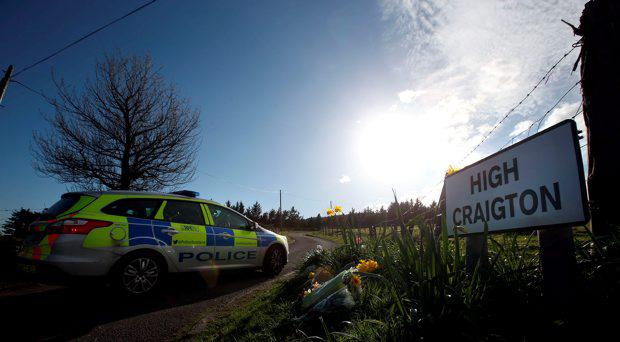 Police activity and floral tributes at High Craigton Farm as remains found by officers investigating the disappearance of Karen Buckley are that of the Irish student, police have said