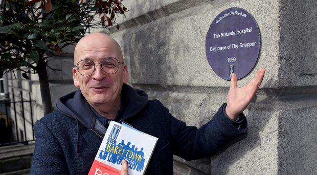 Roddy Doyle unveils a 'plaque' at the Rotunda Hospital (the birth place of The Snapper) for the launch of the One City One Book 2015 programme