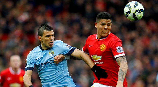 Manchester City's Sergio Aguero in action with Manchester United's Marcos Rojo