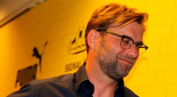 Head coach Juergen Klopp leaves the press conference at Signal Iduna Park on April 15, 2015 in Dortmund, Germany