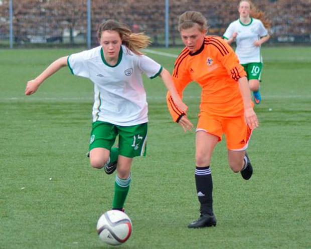 Heather Payne (above) gets to the ball during the clash against Northern Ireland