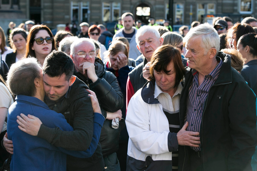 Karen Buckley's parents and brother are comforted in Glasgow this evening. Photo: Mark Condren