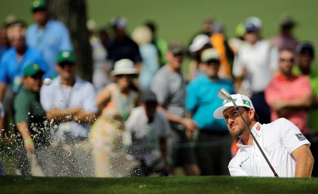 Graeme McDowell, of Northern Ireland, hits out of a bunker on the seventh hole during the second round of the Masters golf tournament Friday, April 10, in Augusta (AP Photo/David J. Phillip)
