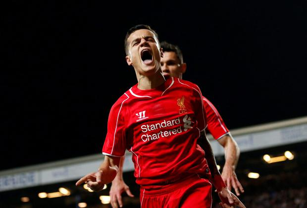 Philippe Coutinho celebrates after scoring the winning goal against Blackburn in the FA Cup quarter-final replay