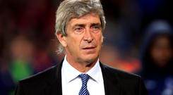 Manchester City manager Manuel Pellegrini has warned his players that a failure to rediscover their form could see them finish as far down the table eighth