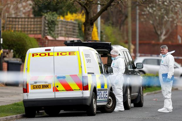 Police forensics officers outside a property in Wocester Road, Bootle where a woman believed to be in her late 20s, was found dead, while a woman in her 50s was discovered at a property in Brookhill Road in Bootle Credit: Lynne Cameron/PA Wire