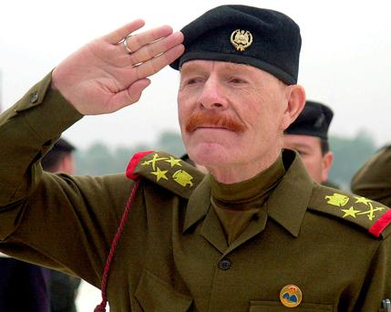 Izzat Ibrahim al-Douri salutes during a ceremony at the Martyrs Monument in Baghdad, Iraq. Photo: AP