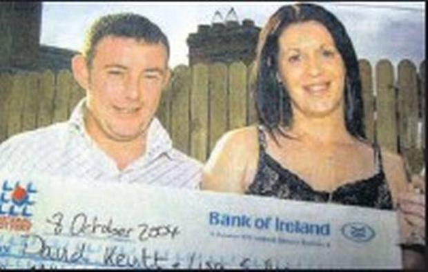 David Kevitt and his partner Lisa pictured with a cheque in 2004