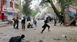 People run for cover after an explosion in Jalalabad killed 33 people Credit: REUTERS/Parwiz