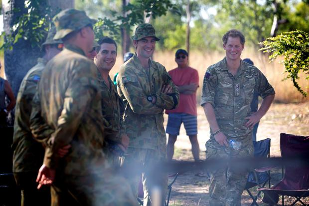 Britain's PrInce Harry (R), known as Captain Wales, laughs with members of the North-West Mobile Force (NORFORCE) during a visit to Kununurra, Western Australia, in this picture dated April 9, 2015 and handed out by the Australian Department of Defence