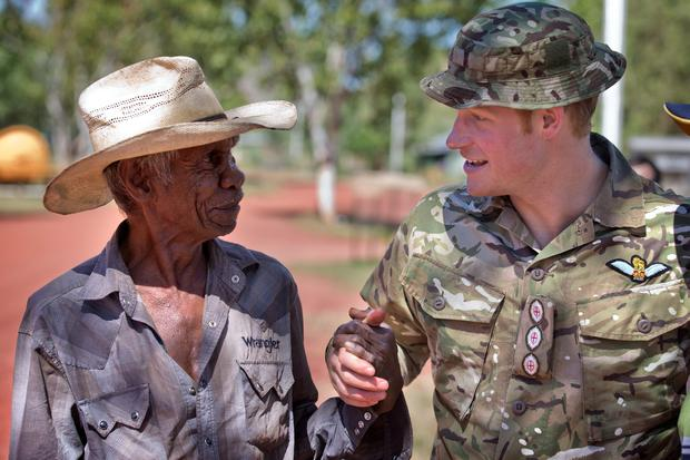 Australian Defence Force undated handout photo of Prince Harry, known as Captain Wales in the British Army, shakes hands with Russel Smith during a visit to the Wuggubun community, with members of the Australian Army's North-West Mobile Force (NORFORCE) in the Kununurra region of Western Australia