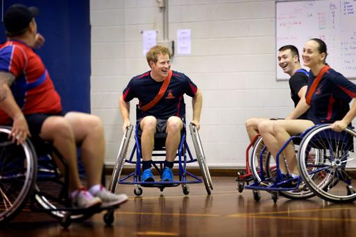 Prince Harry with members of the Soldier Recover Centre after a game of wheelchair AFL at Robertson Barracks in Darwin