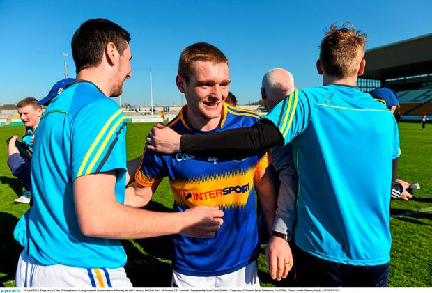 18 April 2015; Tipperary's Colm O'Shaughnessy is congratulated by team-mates following his side's victory. EirGrid GAA All-Ireland U21 Football Championship Semi-Final, Dublin v Tipperary. O'Connor Park, Tullamore, Co. Offaly. Picture credit: Ramsey Cardy / SPORTSFILE