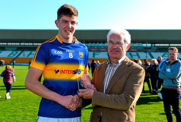 18 April 2015; Tipperary's Steven O'Brien is presented with the EirGrid Man of the Match award by John O'Connor, Chairman, EirGrid. EirGrid GAA All-Ireland U21 Football Championship Semi-Final, Dublin v Tipperary. O'Connor Park, Tullamore, Co. Offaly. Picture credit: Ramsey Cardy / SPORTSFILE