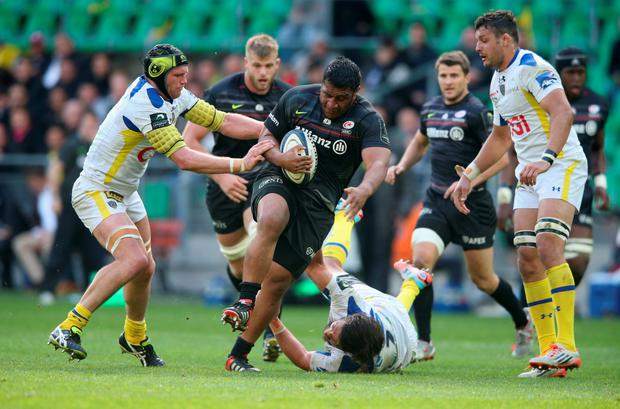SAINT-ETIENNE, FRANCE - APRIL 18: Mako Vunipola of Saracens breaks past Julien Bonnaire (L) during the European Rugby Champions Cup semi final match between ASM Clermont Auvergne and Saracens at Stade Geoffroy-Guichard on April 18, 2015 in Saint-Etienne, France. (Photo by David Rogers/Getty Images)