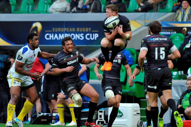 Saracens's British David Strettle (C) jumps to try catching the ball during the European Rugby Champions Cup semi-final match between Clermont and Saracens at Geoffroy-Guichard stadium in Saint-Etienne, central France, on April 18, 2015. French giants Clermont edged Saracens 13-9 to advance to the final where they will play the winner of Toulon's clash with Leinster. AFP PHOTO / THIERRY ZOCCOLANTHIERRY ZOCCOLAN/AFP/Getty Images