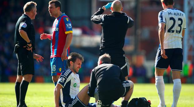 LONDON, ENGLAND - APRIL 18: Gareth McAuley of West Brom receives treatment during the Barclays Premier League match between Crystal Palace and West Bromwich Albion at Selhurst Park on April 18, 2015 in London, England. (Photo by Charlie Crowhurst/Getty Images)