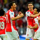 Alexis Sanchez of Arsenal (R) celebrates with Santi Cazorla (L), Mesut Oezil (2L)