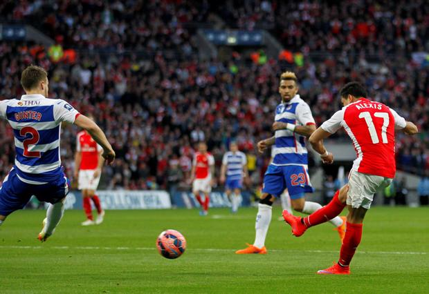 Arsenal's Chilean striker Alexis Sanchez scores his second goal during the FA Cup semi-final between Arsenal and Reading at Wembley stadium in London on April 18, 2015. AFP PHOTO / IAN KINGTON NOT FOR MARKETING OR ADVERTISING USE / RESTRICTED TO EDITORIAL USEIAN KINGTON/AFP/Getty Images