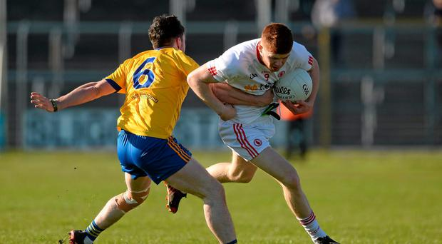 Tyrone's Cathal McShane tries to get past Cathal Kenny