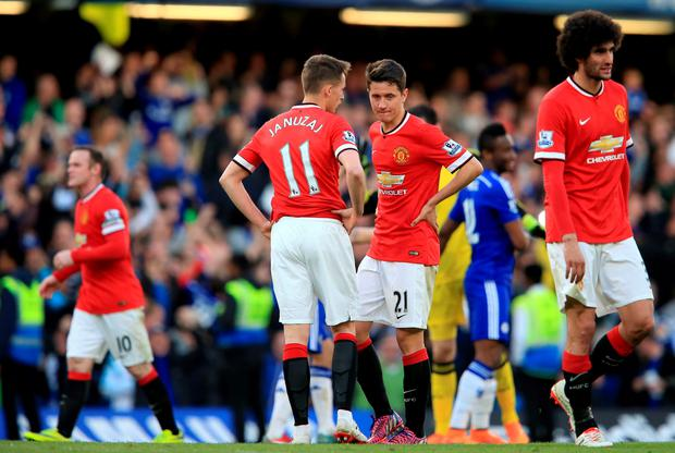 Manchester United's Adnan Januzaj (left) and Manchester United's Ander Herrera (right) dejected during the Barclays Premier League match at Stamford Bridge, London